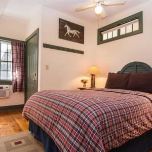 Photo of queen bed in Upper Lodge room on second floor