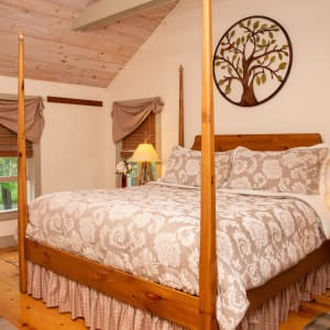 Four poster king sized bed in Pines Suite Duplex