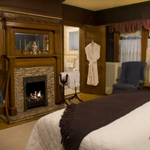 Bed and Fireplace in the Master Bedroom Suite