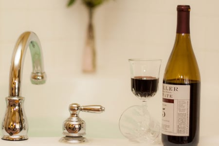 Enjoy a glass of local wine while relaxing in the jetted tub for two