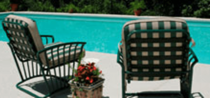 pool area with chairs