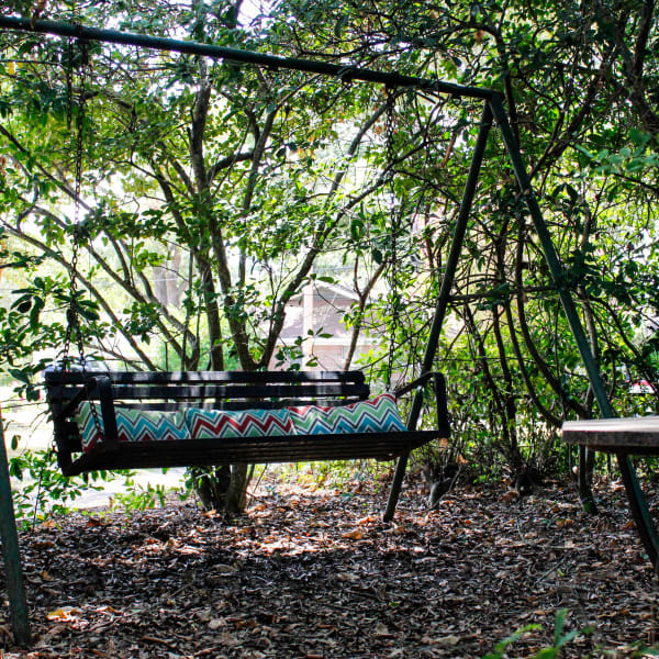 Relax with a book in the Hidden Gardens.