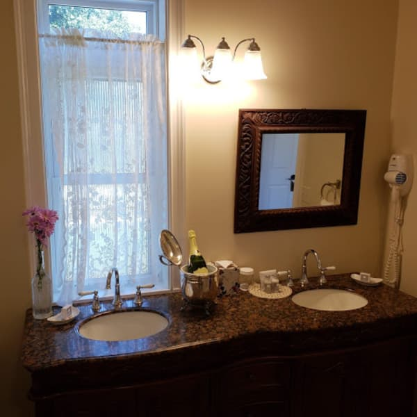 Double sink vanity with granite top and a view!