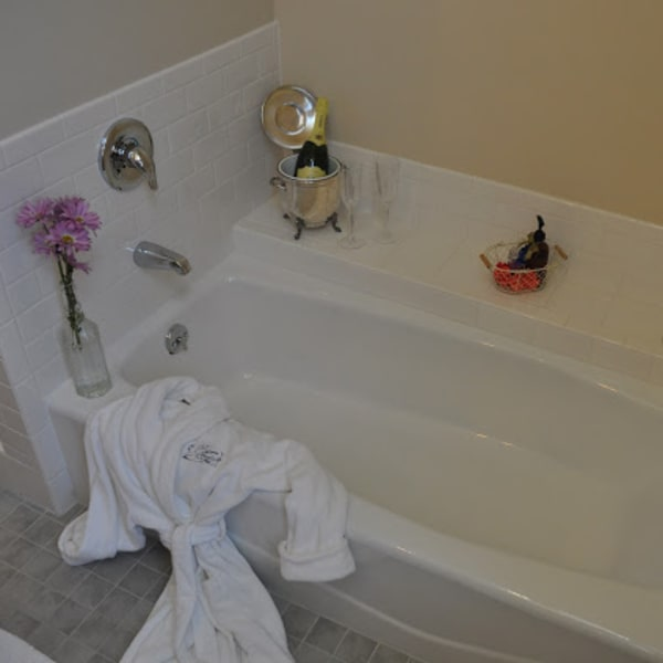 Porcelean Bathtub with custom tile surrounf for that afternoon soak
