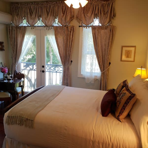 Pillow top Antique queen bed overlooking the river through the Juiliette Balcony french doors