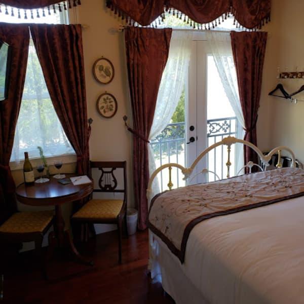 "Pillow Top Antique Queen Bed  overlooking the river through the ""Juiliette Balcony's French Doors!"