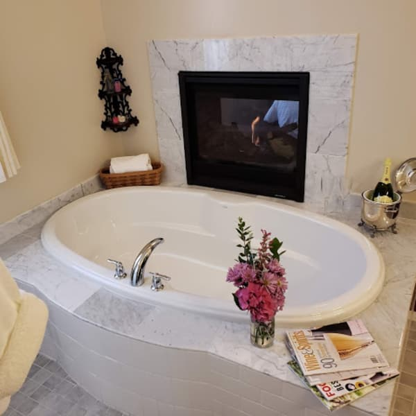 Oval deep soaking tandem tub by the fireplace!