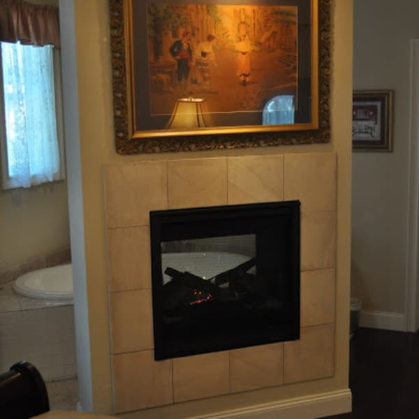 See thru fireplace to the oval tandem deep soaking tub