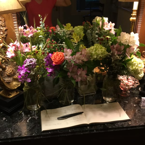 guest book and flowers