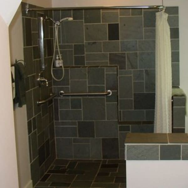 Garden Room shower - roll in with assistive shower head, sitting stool, heavy duty grab rails