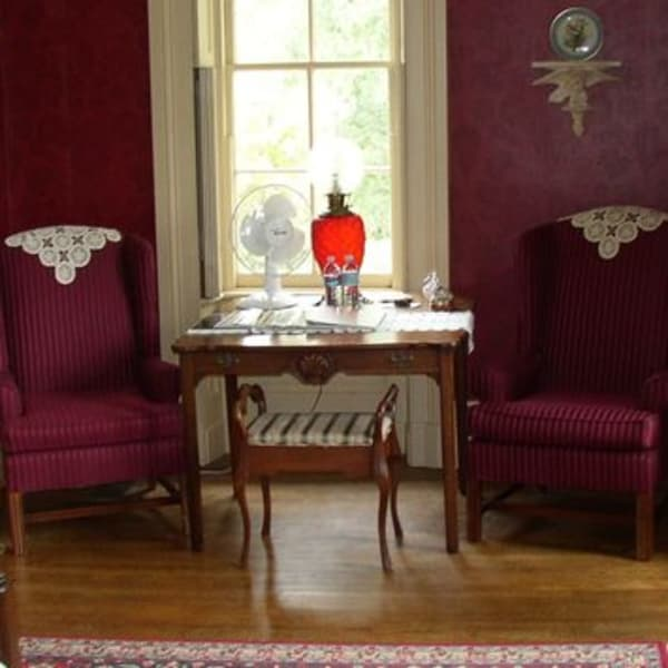 Madison Room Sitting area with toe wing back chairs  and table with lamp