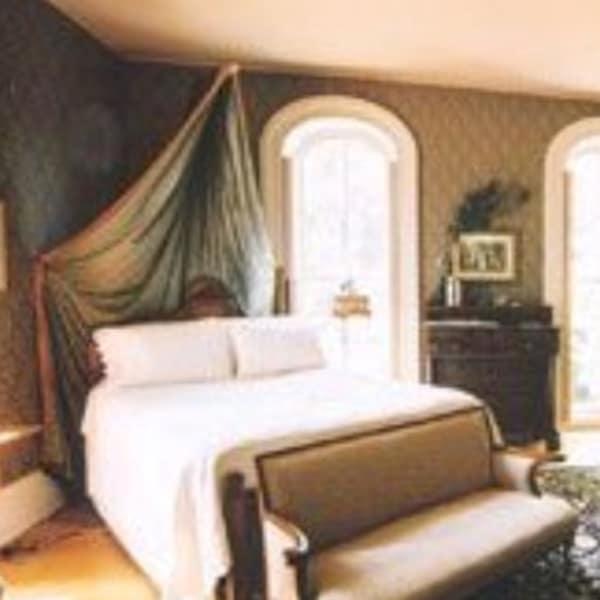 Generals Room showing bed, dresser, windows overlooking side yard. Other window overlooks patio and gardens