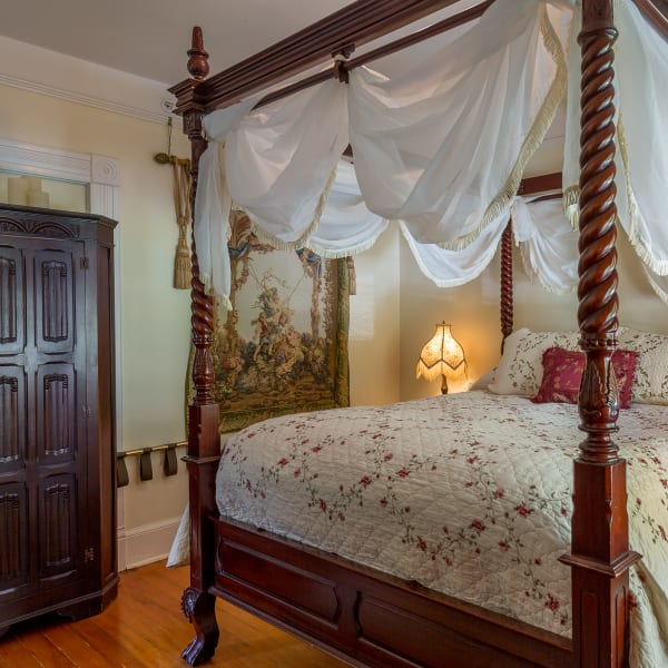Queen Anne has a romantic and elegant 4 poster bed with sheers.