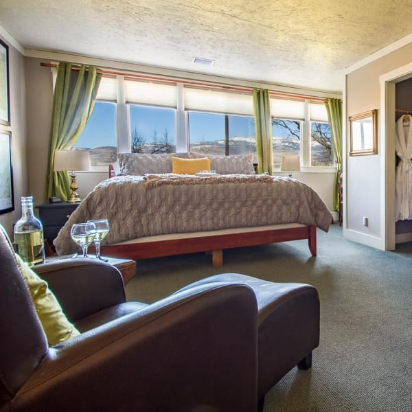 King bed, chair and view of Grizzly Peak thru windows