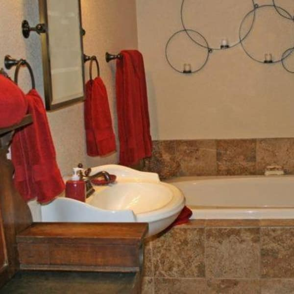 The bathroom in the Brameberry has modern decorations and red accent colors.