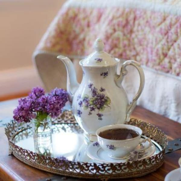 Morning tea in a carafe and teacup with lavendar