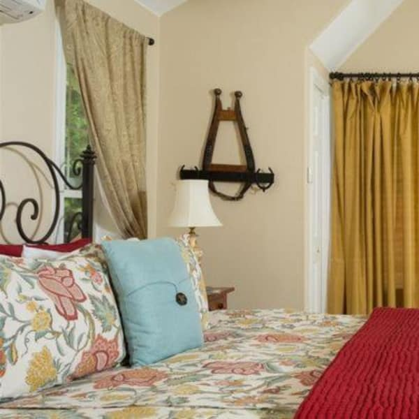 A look across the comfortable bed in the Honeymoon Sweet