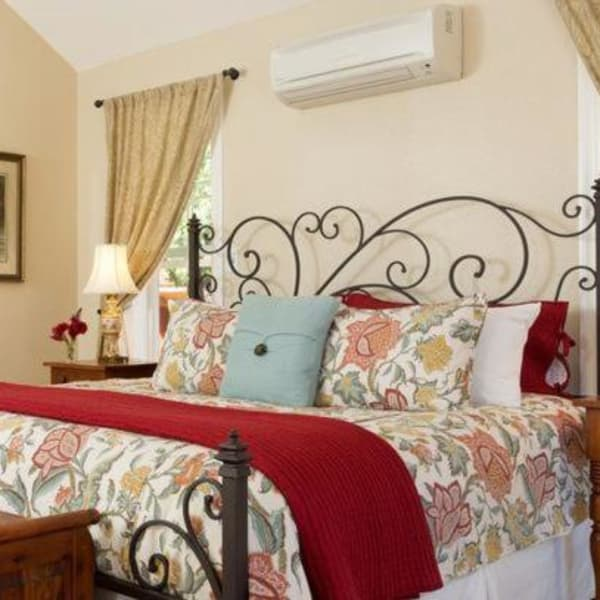 A cozy bed with floral decorations