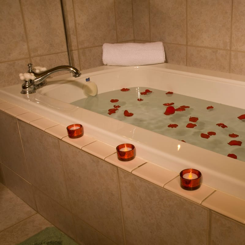 spa tub with red rose peddles