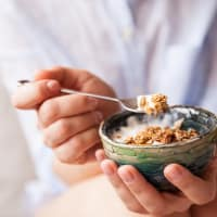 person holding bowl of oatmeal