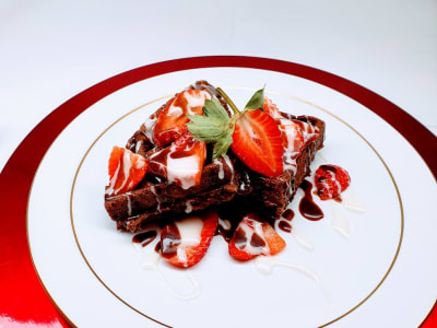 Chocolate Waffles with Strawberries & Fudge Syrup
