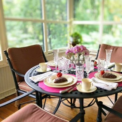 small dining table with place settings