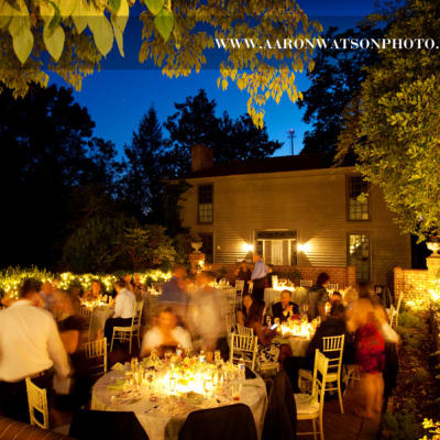 Picture of Patio Reception for 64 people shwing people seated and lighting on and around patio