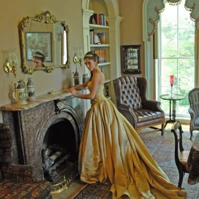 Beautiful Bride in an incredible Gold Dress posing in front of Library Fireplace