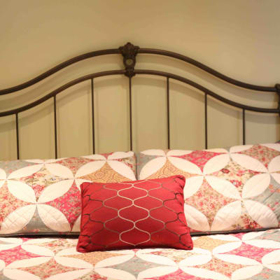 room with iron bed